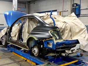 Broken blue BMW at our authorized body shops