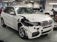 Broken white BMW SUV