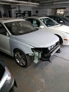 white car with no front bumper