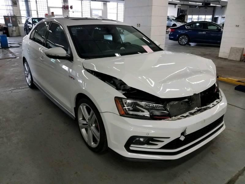 white volkswagen front damaged